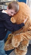 Lad meets Lion - hugs all round